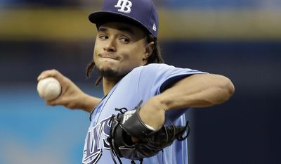 Tampa Bay Rays' Chris Archer goes into his windup against the Milwaukee Brewers during the first inning of an interleague baseball game, Sunday, Aug. 6, 2017, in St. Petersburg, Fla. (AP Photo/Chris O'Meara)