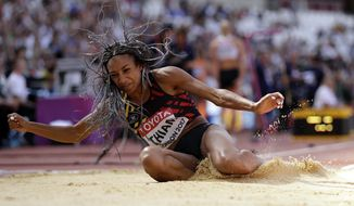 Belgium's Nafissatou Thiam makes an attempt in the long jump of the heptathlon during the World Athletics Championships in London Sunday, Aug. 6, 2017. (AP Photo/Matt Dunham)