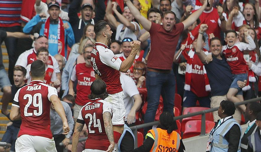 Arsenal players celebrate after scoring during the English Community Shield soccer match between Arsenal and Chelsea at Wembley Stadium in London, Sunday, Aug. 6, 2017. (AP Photo/Frank Augstein)