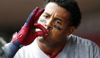 St. Louis Cardinals' Jose Martinez celebrates his grand slam off Cincinnati Reds starting pitcher Homer Bailey during the fourth inning of a baseball game, Sunday, Aug. 6, 2017, in Cincinnati. (AP Photo/Gary Landers)