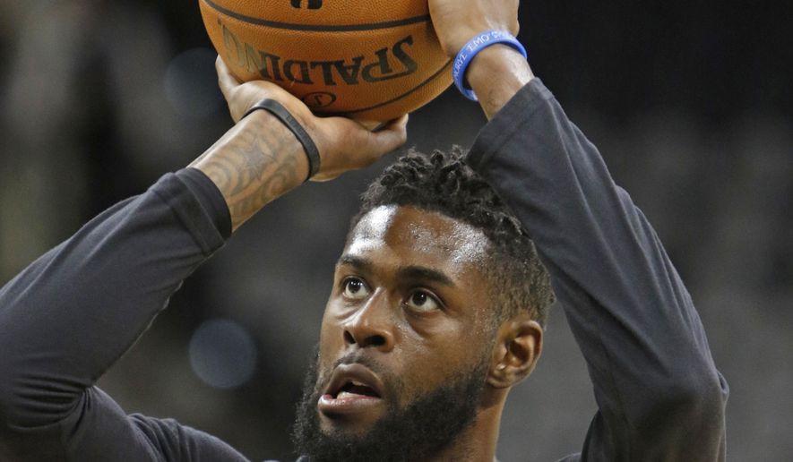 FILE - This Nov. 14, 2016 file photo shows Miami Heat forward Willie Reed (35) taking a practice shot before the start of an NBA basketball game against the San Antonio Spurs in San Antonio. Reed has been jailed in Miami on a battery charge, with officials saying it stemmed from a domestic violence incident. Reed spent last season with the Heat and had been working out in Miami in recent days. The 27-year-old center finalized a $1.5 million, one-year contract with the Los Angeles Clippers last week, despite his hopes for a longer-term, more lucrative contract in free agency. He was booked Sunday, Aug. 6, 2017. (AP Photo/Ronald Cortes, file)