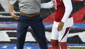 Former St. Louis Rams and Arizona Cardinals quarterback Kurt Warner, left, greets Cardinals wide receiver Larry Fitzgerald before the Pro Football Hall of Fame NFL preseason game in Canton, Ohio, Thursday, Aug. 3, 2017. Warner is to be inducted into the Hall of Fame later this month. (AP Photo/Ron Schwane)