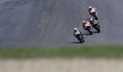 Italian MotoGP rider Valentino Rossi of the Movistar Yamaha MotoGP team leads a pack of riders during the MotoGP race at the Czech Republic motorcycle Grand Prix at the Automotodrom Brno, in Brno, Czech Republic, Sunday, Aug. 6, 2017. (AP Photo/Petr David Josek)