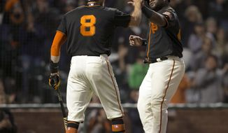 San Francisco Giants' Pablo Sandoval, right, high-fives Hunter Pence (8) as Sandoval socred against the Arizona Diamondbacks during the seventh inning of a baseball game, Saturday, August 5, 2017, in San Francisco. (AP Photo/D. Ross Cameron)