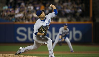 Los Angeles Dodgers starting pitcher Hyun-Jin Ryu (99)  delivers in the first inning against the New York Mets during a baseball game, Sunday Aug. 6, 2017, in New York.(AP Photo/Michael Noble Jr.)