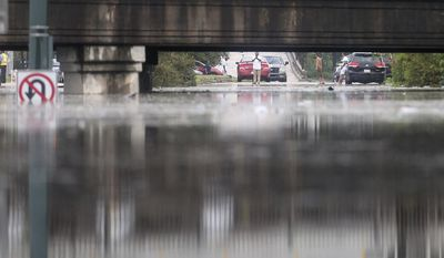 Water rises to over five feet at the Franklin Ave. train underpass near I-610 as a torrential downpour flooded city streets, Saturday, Aug. 5, 2017 in New Orleans. Officials in New Orleans say heavy rainfall overwhelmed the city's pump stations, contributing to flooding in some areas. (Michael DeMocker/NOLA.com The Times-Picayune via AP)