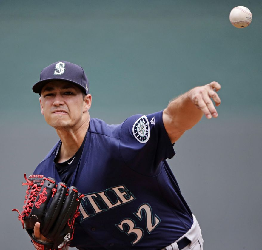 Seattle Mariners starting pitcher Marco Gonzales throws during the first inning of the first baseball game of a doubleheader against the Kansas City Royals, Sunday, Aug. 6, 2017, in Kansas City, Mo. (AP Photo/Charlie Riedel)