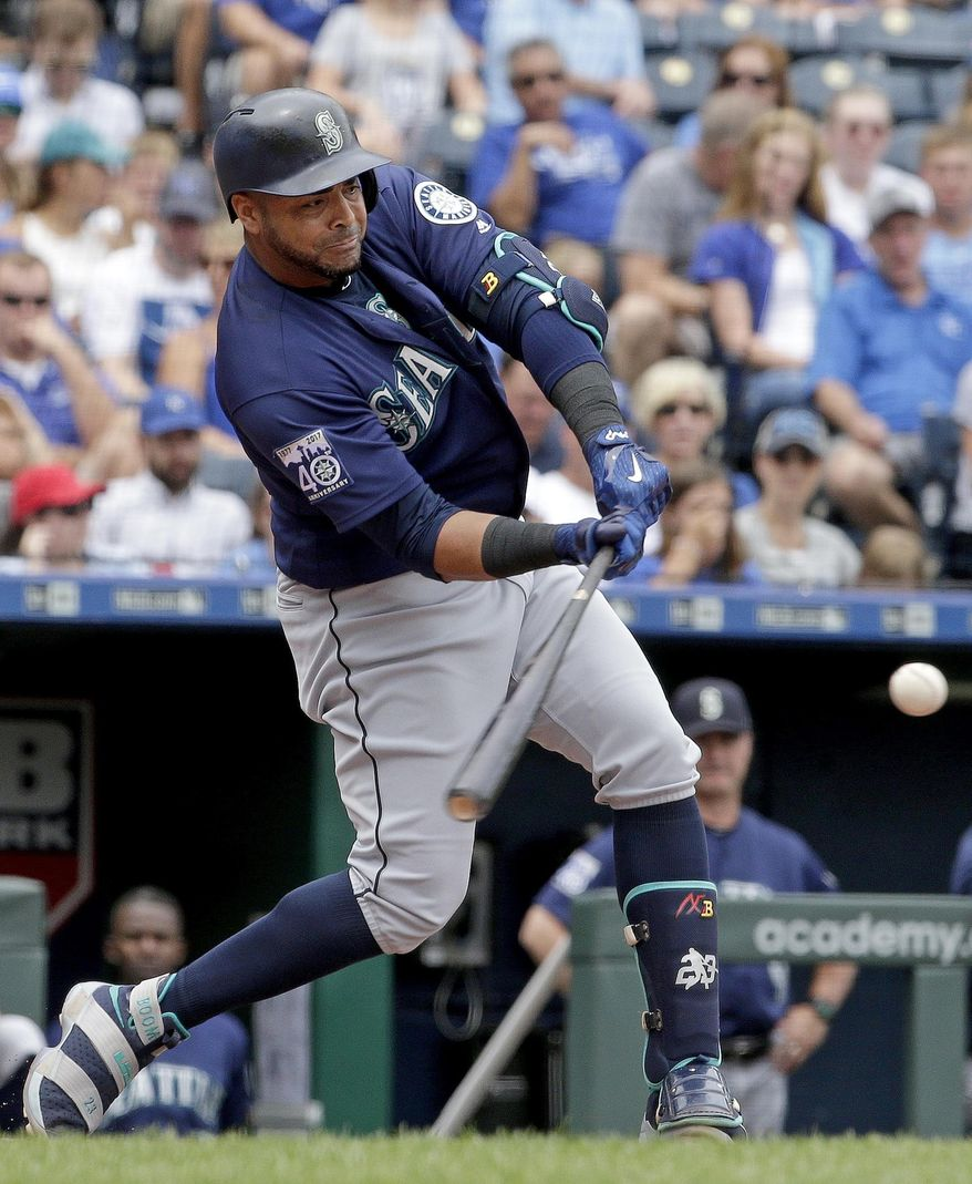 Seattle Mariners' Nelson Cruz hits a three-run home run during the second inning of the first baseball game in a doubleheader against the Kansas City Royals Sunday, Aug. 6, 2017, in Kansas City, Mo. (AP Photo/Charlie Riedel)