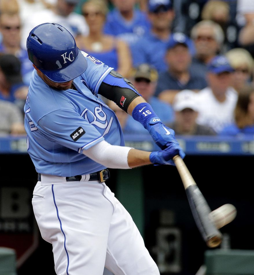 Kansas City Royals' Whit Merrifield hits a two-run home run during the third inning of the first baseball game in a doubleheader against the Seattle Mariners, Sunday, Aug. 6, 2017, in Kansas City, Mo. (AP Photo/Charlie Riedel)