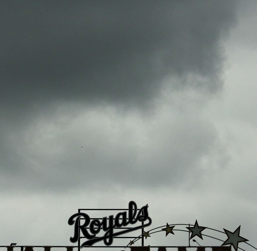 Dark clouds hang over Kauffman Stadium during the third inning of the first baseball game in a doubleheader between the Kansas City Royals and the Seattle Mariners, Sunday, Aug. 6, 2017, in Kansas City, Mo. (AP Photo/Charlie Riedel)