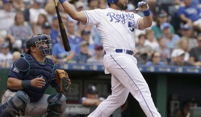 Kansas City Royals' Melky Cabrera hits a three-run home run during the third inning of the second baseball game of a doubleheader against the Seattle Mariners, Sunday, Aug. 6, 2017, in Kansas City, Mo. (AP Photo/Charlie Riedel)