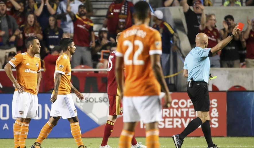Houston Dynamo midfielder Alex (14) is issued a red card during the team's MLS soccer match against Real Salt Lake in Sandy, Utah, Saturday, Aug. 5, 2017. (Spenser Heaps/The Deseret News via AP)