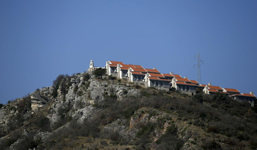 In this photo taken Wednesday, March 15, 2017, a view of the 'Tsar's Village' complex near Sveti Stefan peninsula in Montenegro. Russian tourists are flocking to Montenegro despite warnings from Moscow against their visits to the latest NATO-member country. (AP Photo/Darko Vojinovic)