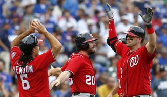 Washington Nationals' Matt Wieters, right, celebrates with Anthony Rendon, left, Daniel Murphy, center, and Ryan Zimmerman after hitting a grand slam during the eighth inning of a baseball game against the Chicago Cubs, Sunday, Aug. 6, 2017, in Chicago. (AP Photo/Nam Y. Huh)