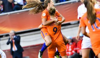 Vivianne Miedema, number 9, of the Netherlands celebrates with teammate Lieke Martens after she scores her side's fourth goal during the Women's Euro 2017 final soccer match between Netherlands and Denmark in Enschede, the Netherlands, Sunday, Aug. 6, 2017. (AP Photo/Patrick Post)