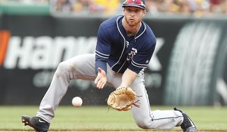 San Diego Padres third baseman Cory Spangenberg fields a ground ball in the seventh inning against the Pittsburgh Pirates during a baseball game in Pittsburgh, Sunday, Aug. 6, 2017. (AP Photo/Jared Wickerham)