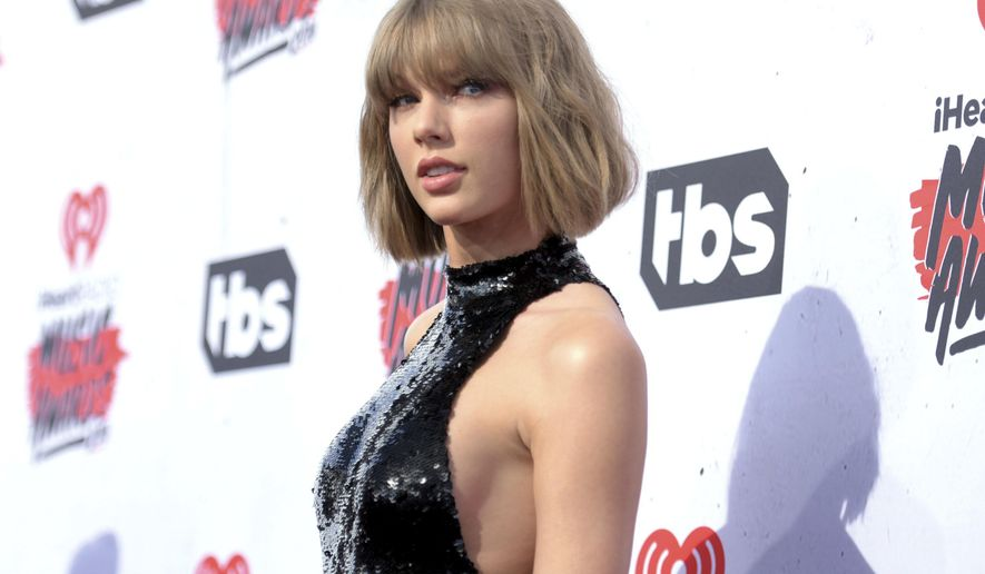 In this April 3, 2016, file photo, Taylor Swift arrives at the iHeartRadio Music Awards in Inglewood, Calif. The trial of a lawsuit between Swift and David Mueller, a former radio host she accuses of groping her, begins Monday, Aug. 7, 2017, in U.S. District Court in Denver. (Photo by Richard Shotwell/Invision/AP, File)
