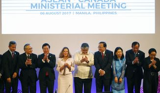 Canadian Foreign Minister Chrystia Freeland, fourth left, applauds with the Association of Southeast Asian Nations foreign ministers and their representatives as they take part in the ASEAN-Canada ministerial meeting of the 50th ASEAN foreign ministers' meeting and its dialogue partners. Sunday, Aug. 6, 2017 in suburban Pasay city, south Manila, Philippines. The Philippines is the chair of the meeting which is represented by Foreign Affairs Undersecretary Enrique Manalo, center. (AP Photo/Bullit Marquez, POOL)