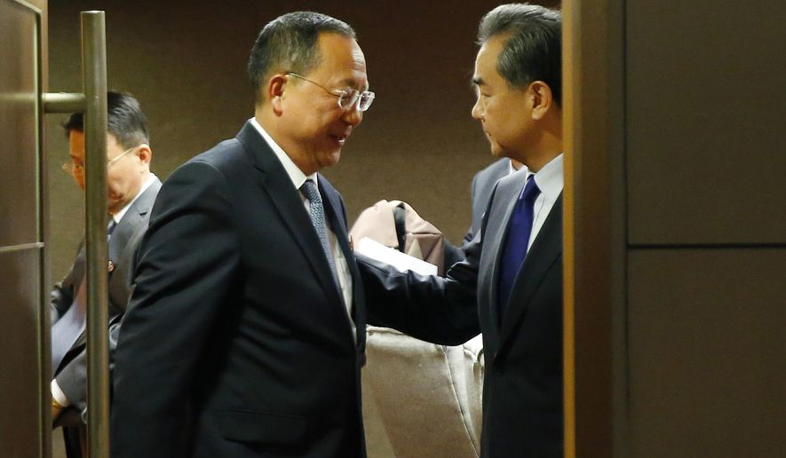 North Korean Foreign Minister Ri Yong Ho, center, bids farewell to his Chinese counterpart Wang Yi, right, following their bilateral meeting in the sidelines of the 50th ASEAN Foreign Ministers' Meeting and its Dialogue Partners Sunday, Aug. 6, 2017 in suburban Pasay city, south Manila, Philippines. Bolstered by new U.N. sanctions, the United States and North Korea's neighbors are joining in a fresh attempt to isolate Pyongyang over its nuclear and missile programs, in a global campaign cheered on by U.S. President Donald Trump. (AP Photo/Bullit Marquez)