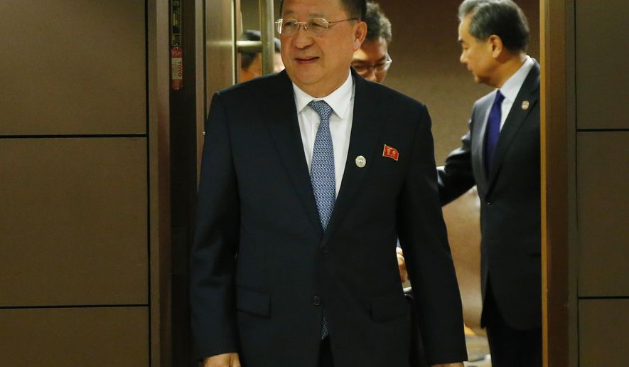 North Korean Foreign Minister Ri Yong Ho emerges from his bilateral meeting with his Chinese counterpart Wang Yi, right, in the sidelines of the 50th ASEAN Foreign Ministers' Meeting and its Dialogue Partners Sunday, Aug. 6, 2017 in suburban Pasay city, south Manila, Philippines. Bolstered by new U.N. sanctions, the United States and North Korea's neighbors are joining in a fresh attempt to isolate Pyongyang over its nuclear and missile programs, in a global campaign cheered on by U.S. President Donald Trump. (AP Photo/Bullit Marquez)