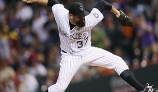 Colorado Rockies relief pitcher Pat Neshek throws to a Philadelphia Phillies batter during the ninth inning of a baseball game Saturday, Aug. 5, 2017, in Denver. Colorado won 8-5. (AP Photo/David Zalubowski)