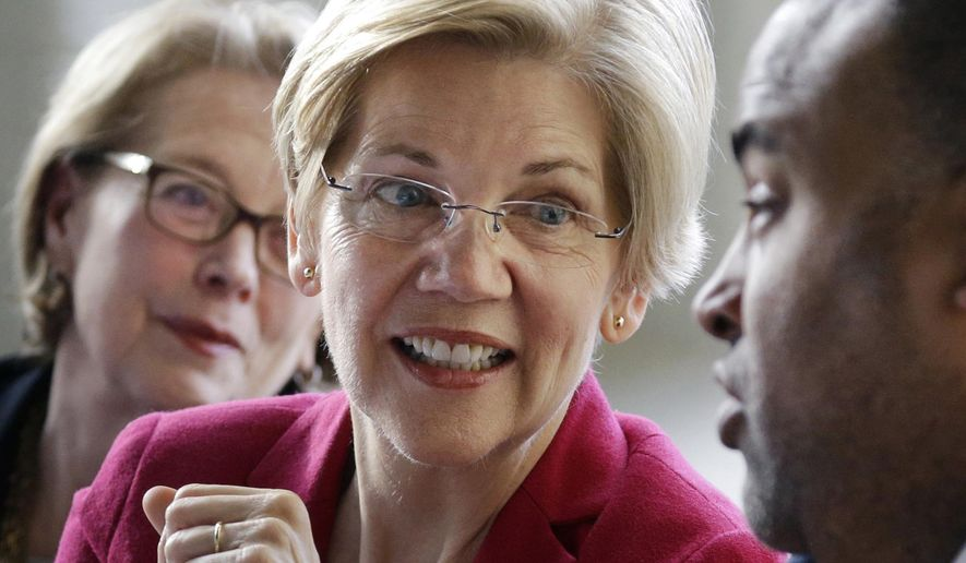 FILE - In this March 3, 2017, file photo, Sen. Elizabeth Warren, D-Mass., center, smiles during a small business roundtable discussion in Lawrence, Mass. At left is Rep. Niki Tsongas, D-Mass., and at right is Lawrence Mayor Daniel Rivera. The Senator won't face re-election until November2018, but two Republicans have announced their candidacies, two others are said to be weighing runs and conservative political groups are chipping away at the candidate. Still, Warren enjoys enormous advantages, including a national base of support, a fat campaign account and solid poll numbers. (AP Photo/Elise Amendola, File)