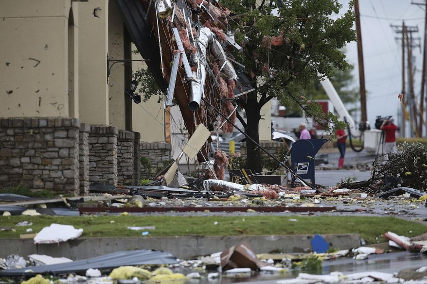 This photo shows damage left by a storm Sunday, Aug. 6, 2017, Tulsa, Okla. A possible tornado struck near midtown Tulsa and causing power outages and roof damage to businesses. (Tom Gilbert/Tulsa World via AP)