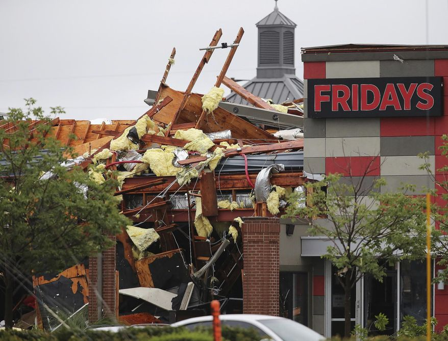This photo shows damage to a Fridays restaurant after a storm moved through the area in Tulsa, Okla., Sunday, Aug. 6, 2017. A possible tornado struck near midtown Tulsa and causing power outages and roof damage to businesses. (Tom Gilbert/Tulsa World via AP)