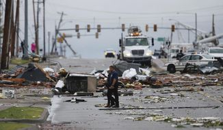 Debris from a storm covers a street in Tulsa, Okla., Sunday, Aug. 6, 2017. A possible tornado struck near midtown Tulsa and causing power outages and roof damage to businesses. (Tom Gilbert/Tulsa World via AP)