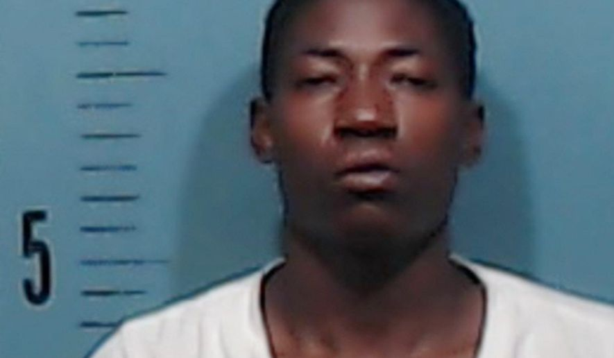 This photo provided by the Abilene Police Department shows Kanyoni Sedekiy, who was arrested before dawn Friday, Aug. 4, 2017, at an Abilene, Texas, apartment complex. Sedekiy was held Sunday, Aug. 6, on an aggravated robbery charge, after investigators say he was caught snoozing at the scene. (Abilene Police Department via AP)