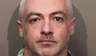 This undated photo released by the Alameda County, Calif., Sheriff's Office shows Wyndham Lathem, an associate professor of microbiology at Northwestern University. Lathem and Andrew Warren, an employee of the University of Oxford in Britain, were jailed in the San Francisco area in connection with the death of a young hairdresser in Chicago, police said. Lathem faces a Monday, Aug. 7, 2017, court appearance in the city of Pleasanton, Calif. (Alameda County Sheriff's Office via AP)