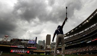 Texas Rangers Elvis Andrus (1) warms up before batting against the Minnesota Twins in the first inning during a baseball game on Sunday, Aug. 6, 2017, in Minneapolis. A brief rain delay in the second inning paused the game. (AP Photo/Andy Clayton-King)