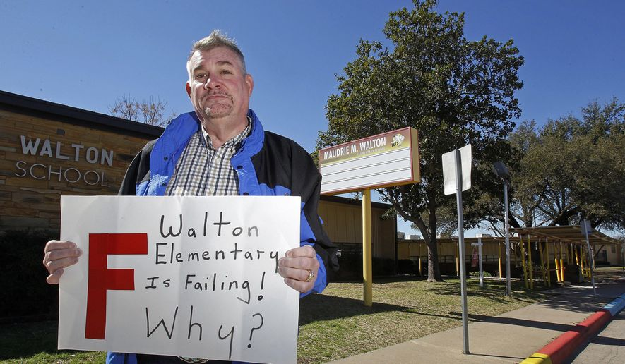 In this Feb. 24, 2016 photo, Randy Gamel is photographed at Maudrie M. Walton Elementary in Fort Worth, Texas. Gamel, a retiree who moved with his husband to a tiny western Oklahoma town alleges he was routinely harassed by townspeople, but was ignored by law enforcement until his home was burned. Gamel acknowledges that before moving to Oklahoma, his criticism of staff and teachers at his son's Fort Worth elementary school became so heated that district officials prohibited him last year from visiting the school. He filed a lawsuit Thursday, Aug. 3, 2017, that suggests he was targeted in part because he and his partner brought a black child into the nearly all-white town of Hitchcock, Okla. (Khampha Bouaphanh/Star-Telegram via AP)