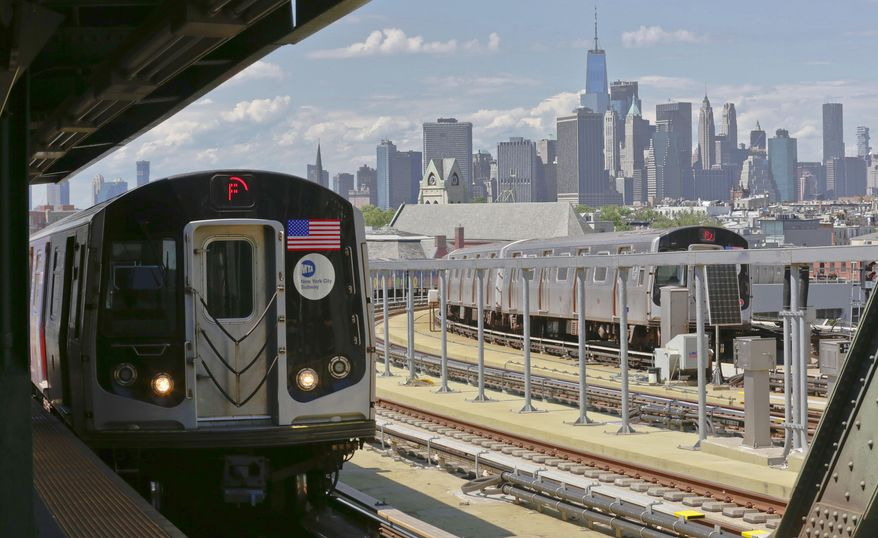 In this June 21, 2017 file photo, a subway train approaches the platform at Brooklyn's Smith Street above-ground subway station, in New York. (AP Photo/Bebeto Matthews, File)