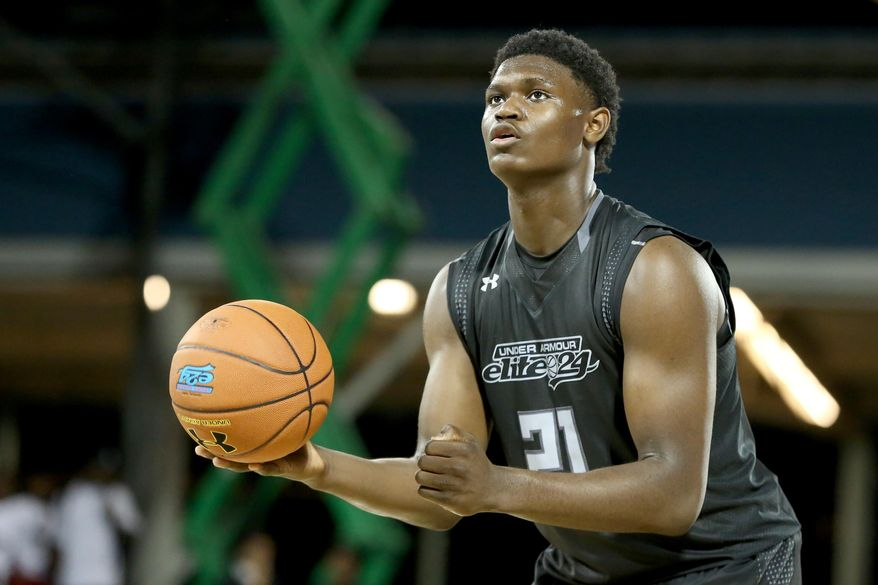 FILE - In this Aug. 20, 2016, file photo, Team Drive's Zion Williamson shoots a free throw against Team Clutch in the Under Armour Elite 24 basketball game in New York. Williams was among the top recruits who played in tournaments around Las Vegas the last week of July during the live recruiting period for college coaches. (AP Photo/Gregory Payan, File)