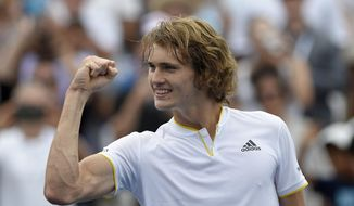 Alexander Zverev, of Germany, pumps his fist to the crowd as he celebrates his win over Kevin Anderson, of South Africa, in the finals of the Citi Open tennis tournament, Sunday, Aug. 6, 2017, in Washington. Zverev won 6-4, 6-4. (AP Photo/Nick Wass)