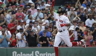 Boston Red Sox's Chris Young celebrates as he arrives at home plate after hitting a three-run home run off a pitch by Chicago White Sox's Mike Pelfrey in the fifth inning of a baseball game, Sunday, Aug. 6, 2017, in Boston. (AP Photo/Steven Senne)