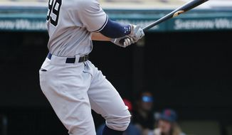 New York Yankees' Aaron Judge hits a three-run home run off Cleveland Indians pitcher Mike Clevinger during the seventh inning of a baseball game, Sunday, Aug. 6, 2017, in Cleveland. (AP Photo/Ron Schwane)