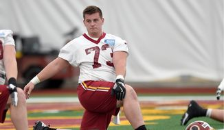 Washington Redskins rookie center Chase Roullier is used to long hours learning about power and leverage. His degree from Wyoming is in mechanical engineering. (Associated Press)