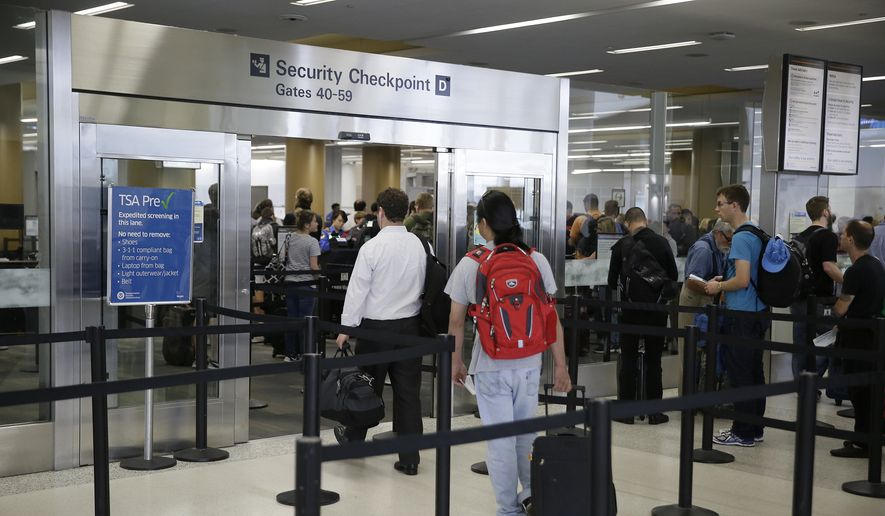In this Wednesday, June 29, 2016, photo, a pair of travelers, at left, walk through a TSA Precheck security line, while other passengers wait in line to be screened, in Terminal 2 of San Francisco International Airport in San Francisco. Passengers at all U.S. airports will soon face new measures for screening electronic devices bigger than a cellphone. Security officers will ask travelers in regular lanes to take all larger devices out of their bag and put them in a bin by themselves, similar to the screening of most travelers laptops. Officials say it gives X-ray screeners a clearer picture of the devices. The change wont apply to Precheck lanes. (AP Photo/Eric Risberg)