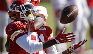 Kansas City Chiefs cornerback DeVante Bausby, rear, breaks up a pass intended for wide receiver Seantavius Jones (81) during NFL football training camp Friday, Aug. 4, 2017, in St. Joseph, Mo. (AP Photo/Charlie Riedel)