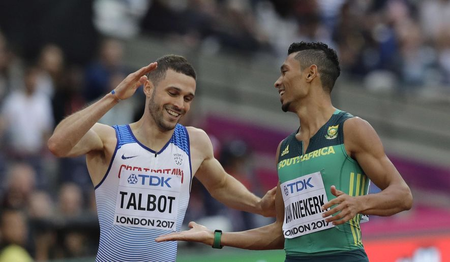 South Africa's Wayde Van Niekerk and Britain's Daniel Talbot, left, joke as they cross the finish line in their Men's 200 meters heat at the World Athletics Championships in London Monday, Aug. 7, 2017. (AP Photo/Tim Ireland)