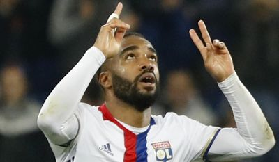 FILE - This is a Thursday, May 11, 2017 file photo of Lyon's Alexandre Lacazette celebrates scoring during the second leg semi final soccer match between Olympique Lyon and Ajax in the Stade de Lyon, Decines, France. Upon joining Arsenal, Alexandre Lacazette revealed that he followed the club as a child because of Thierry Henry. If the 26-year-old France striker can score half as many goals for the Gunners as Henry did, the club-record 60 million euros ($68 million) spent on signing him from Lyon will surely be worth it. (AP Photo/Laurent Cipriani, File)