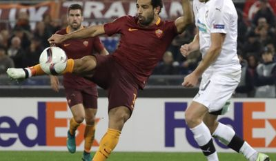 FILE - This is a Thursday, Nov. 24, 2016 file photo of Roma's Mohamed Salah, left, as he tries a shot as Viktoria Pilsen's Jan Kopic opposes him during the Europa League group E soccer match between Roma and Viktoria Pilsen, in Rome's Olympic stadium. After sealing a return to the Premier League with Liverpool, Mohamed Salah is hoping to become the latest player to prove Chelsea wrong. The 25-year-old Egyptian arrived at Stamford Bridge in January 2014, but he rarely played during an uninspiring 12 months before being loaned out to Fiorentina and eventually sold to Roma last year. (AP Photo/Andrew Medichini, File)
