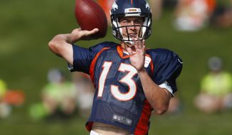 Denver Broncos quarterback Trevor Siemian throws a pass during an NFL football training camp, Saturday, Aug. 5, 2017, in Englewood, Colo. (AP Photo/David Zalubowski)