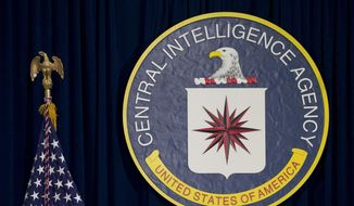 This April 13, 2016 file photo shows the seal of the Central Intelligence Agency at CIA headquarters in Langley, Va. (AP Photo/Carolyn Kaster, File) **FILE**