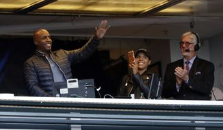 Former San Francisco Giants player Barry Bonds, left, waves to fans from the broadcast booth next to broadcaster Mike Krukow, right, during a baseball game against the Chicago Cubs, Monday, Aug. 7, 2017, in San Francisco. (AP Photo/Marcio Jose Sanchez)