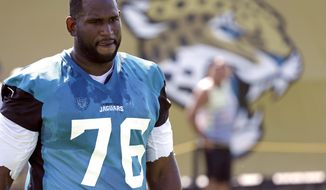 FILE - In this July 28, 2017, file photo, Jacksonville Jaguars offensive lineman Branden Albert (76) arrives at practice during NFL football training camp, in Jacksonville, Fla. A person familiar with the situation says Albert has changed his mind about retiring and asked to return to the team. The person spoke to The Associated Press on the condition of anonymity Monday, Aug. 7, because neither side has publicly discussed details about Albert's potential return. (AP Photo/John Raoux, File)