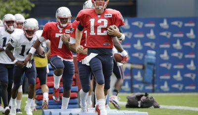New England Patriots quarterback Tom Brady (12) performs agility drills with teammates during an NFL football joint practice with the Jacksonville Jaguars, Monday, Aug. 7, 2017, in Foxborough, Mass. (AP Photo/Steven Senne)