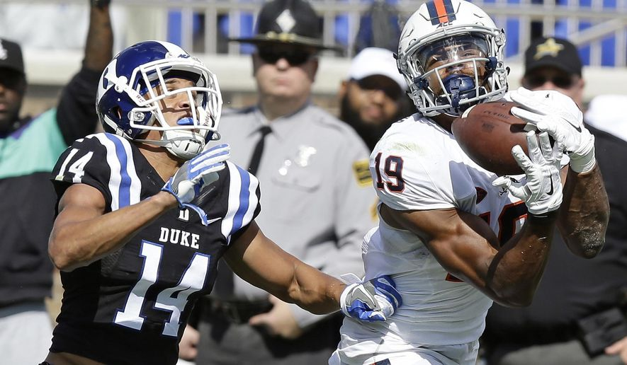 FILe - In this Oct. 1, 2016, file photo, Duke's Bryon Fields (14) defends as Virginia's Andre Levrone (19) catches a pass during the second half of an NCAA college football game in Durham, N.C. Levrone made a big impression on Virginia coach Bronco Mendenhall last year in spring practice. This year, the senior wide receiver hopes to carry that over onto the field.  (AP Photo/Gerry Broome, File)
